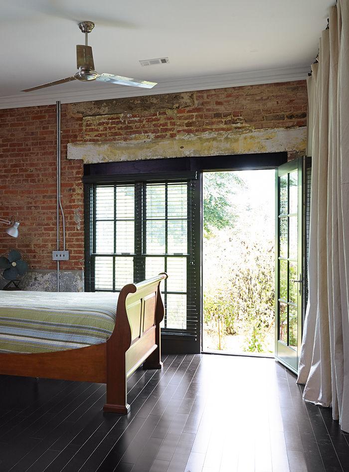 moden auburn bragg house master bedroom industrial fans brick