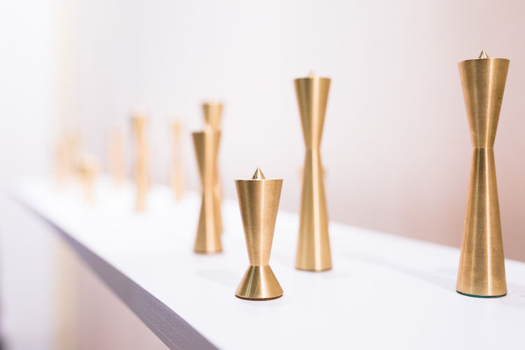 Trio of machined brass candlestick holders