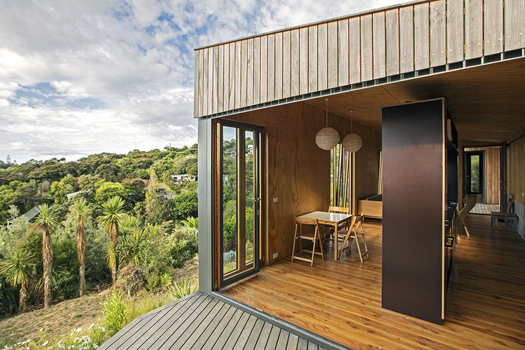 Modern prefab New Zealand beach house with plywood lining the communal area