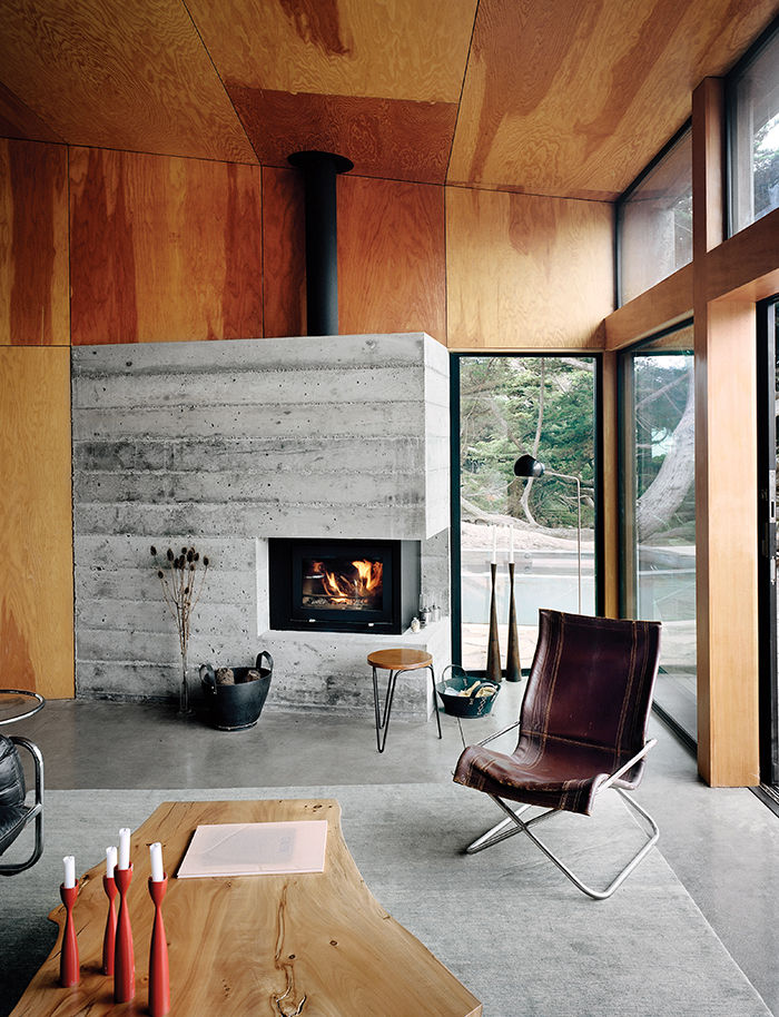 Modern living room in Sea Ranch with a vintage chair and stool