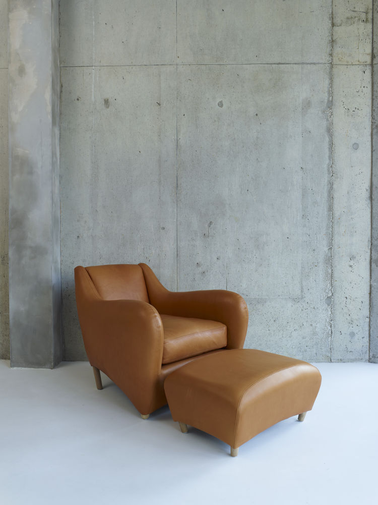 Large leather arm chair with corresponding ottoman