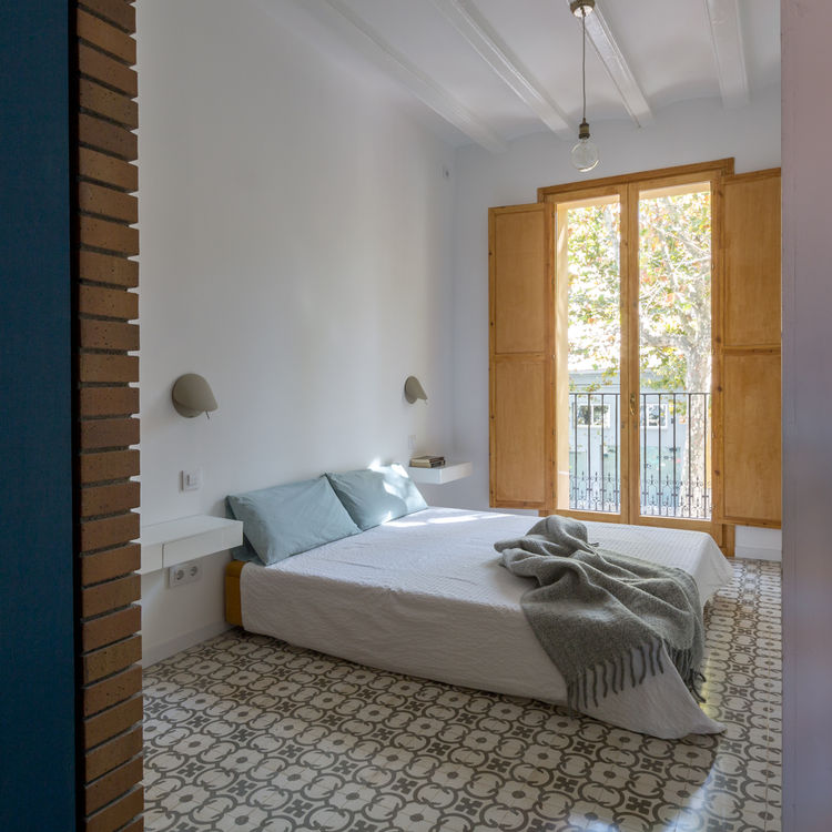 Barcelona bedroom with wooden window frame shutters