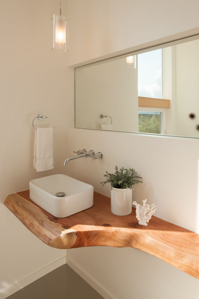 Douglas fir countertop, Kraus ceramic sink, and Danze faucet in bathroom of Seattle home by JW Architects