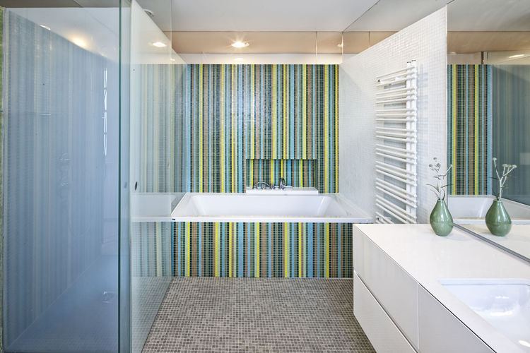 Axor fixtures from Hansgrohe and Trend glass mosaic tiles in bathroom of renovation by 4a Architekten of the Villa Le Trident in the French Riviera.
