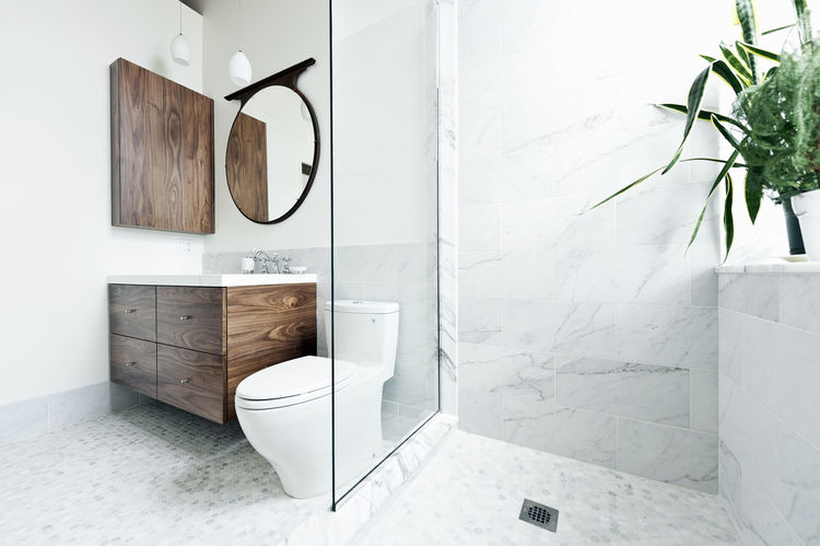 Batimat sink and countertop in marble bathroom of 850 square-foot Montreal apartment renovation by Gepetto.