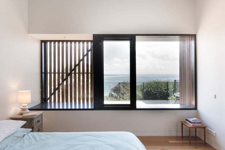 Cross-ventilated bedroom of Australian beach home by OLA Studio