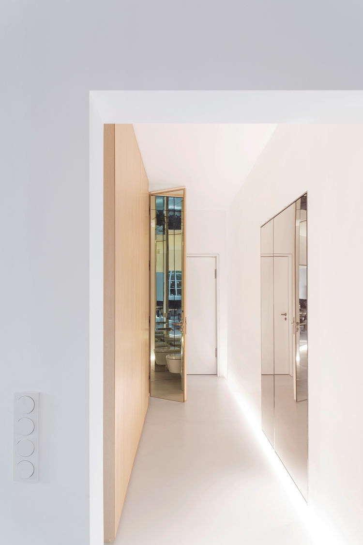 Modern hallway with a mirrored coat closet