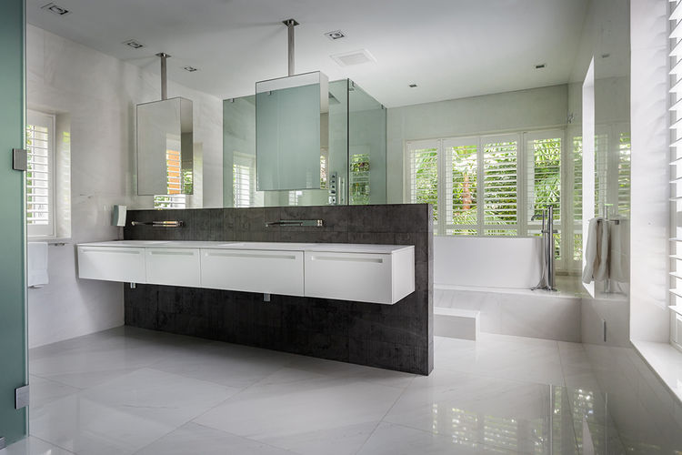 Master bathroom with dark stone