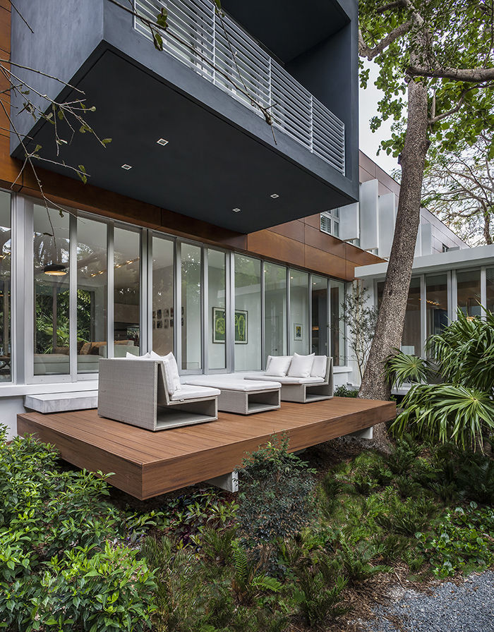 A modern house in Miami with a shaded deck
