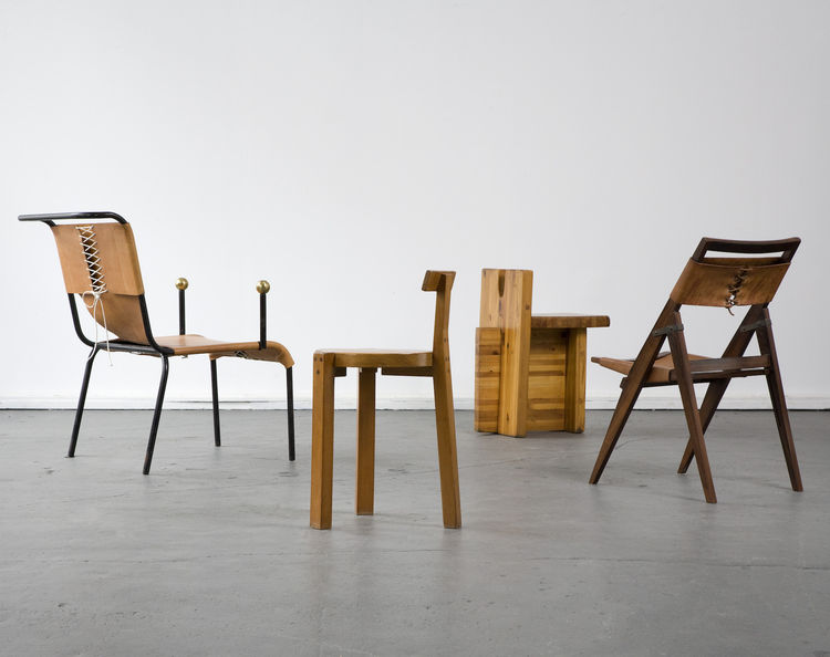 Chairs designed by Lina Bo Bardi.