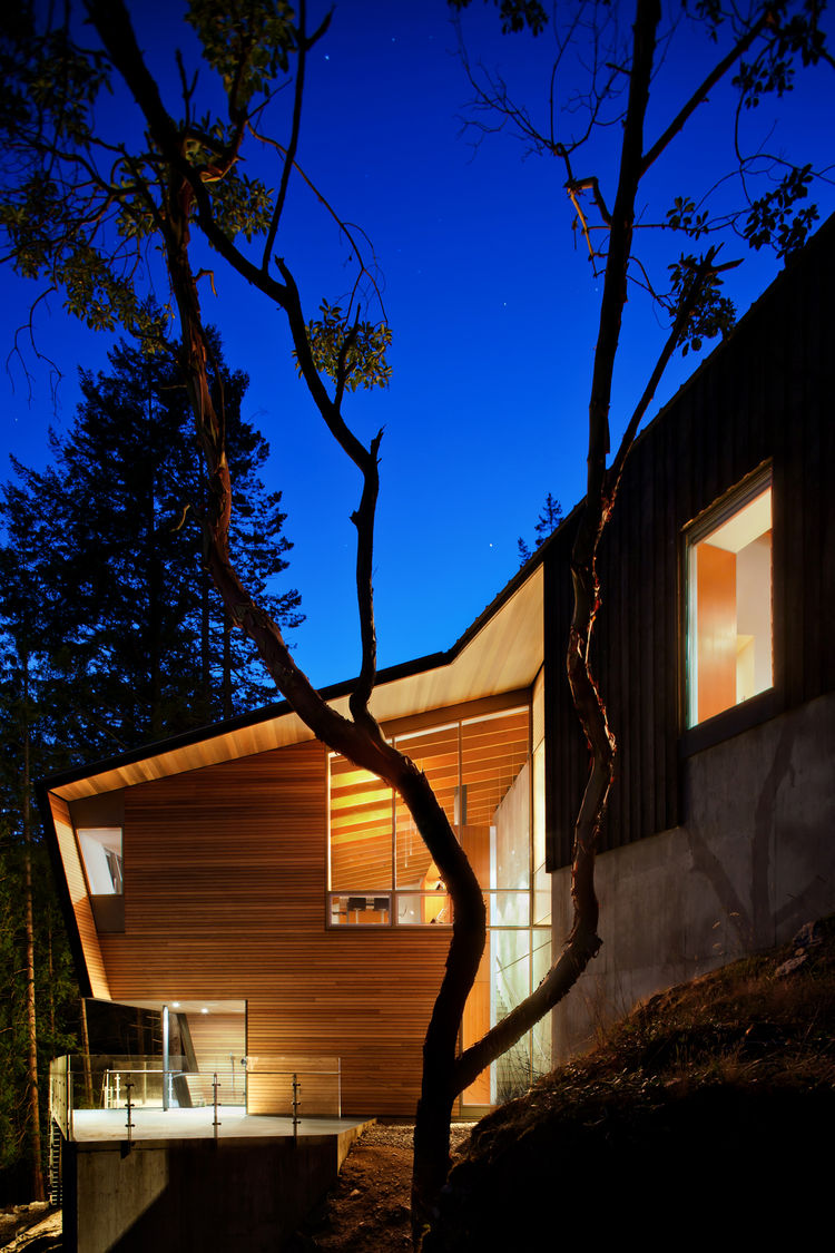 Exterior nighttime view of a British Columbia cabin