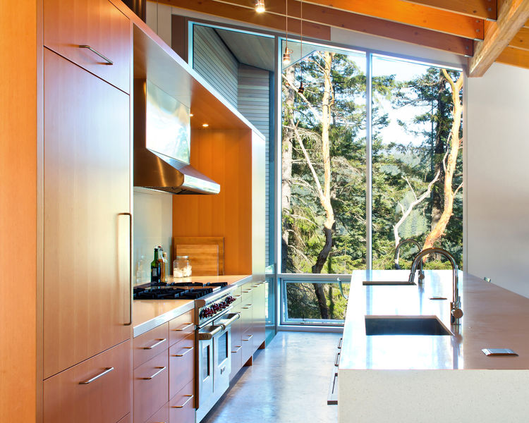 Kitchen with floor to ceiling windows in a British Columbia cabin