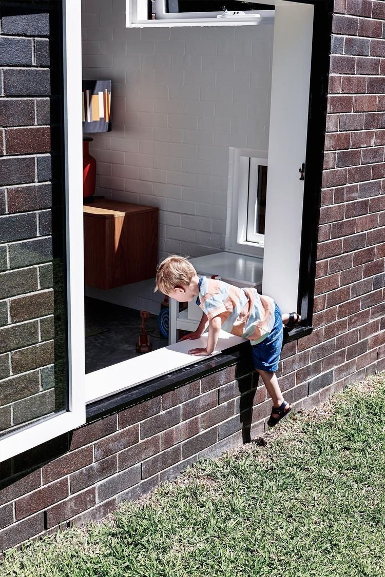 Kid-friendly windows in a modern bungalow addition
