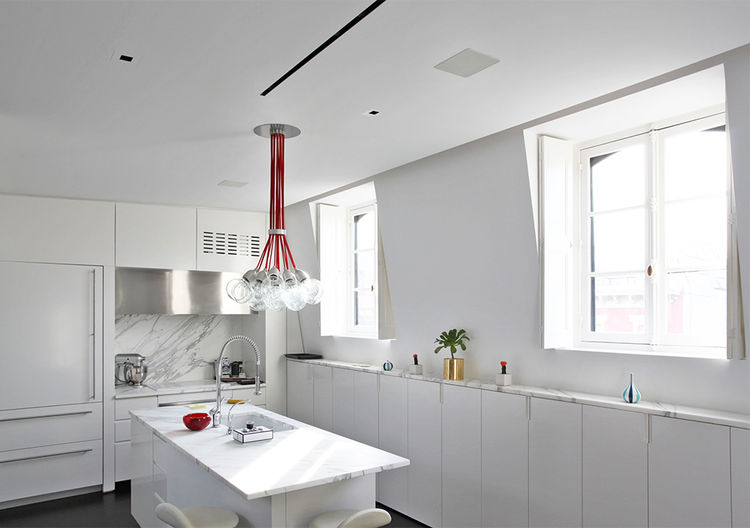 Apartment kitchen with in-ceiling speakers by OneButton