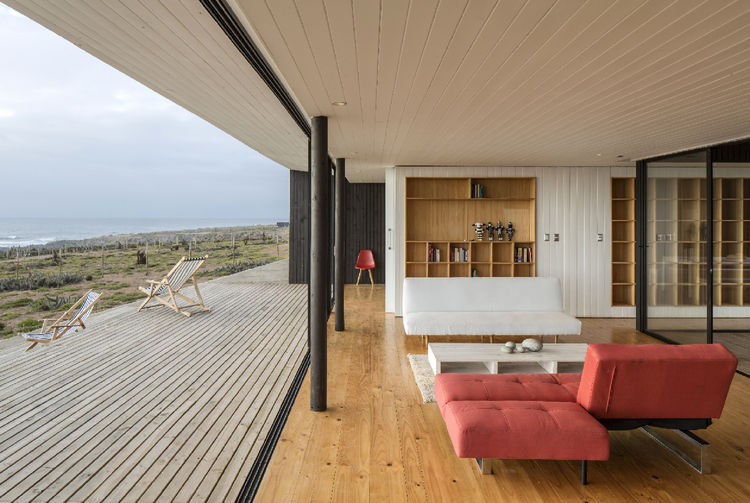 A sofa by Popular Design sits in the living room that leads out to a patio