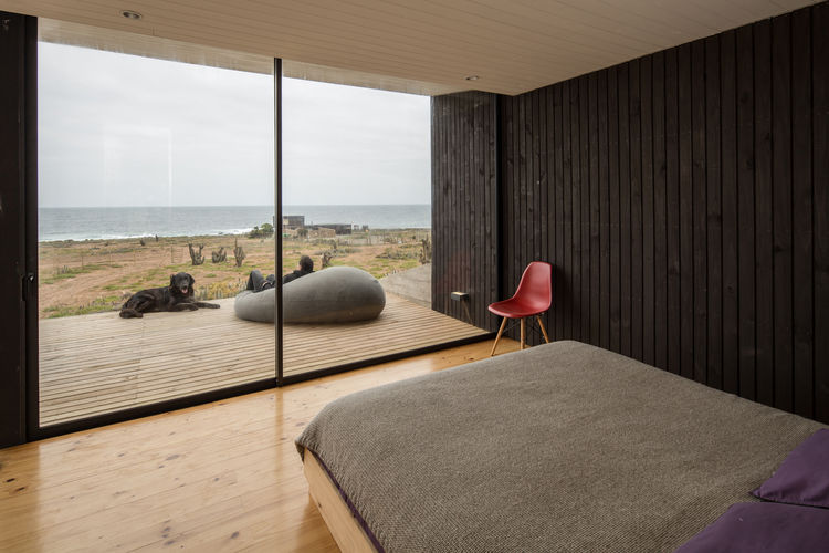 Pine is featured in the bedroom and throughout this home in Chile