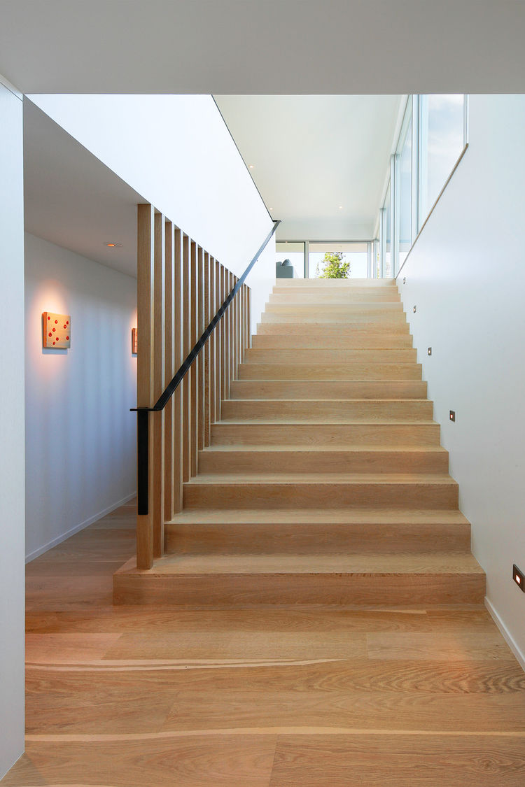 Custom bleached-white oak flooring covers the floors and staircase.