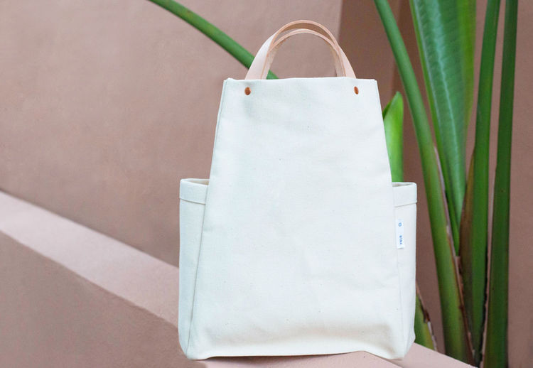 Canvas tote with leather handles and copper rivets