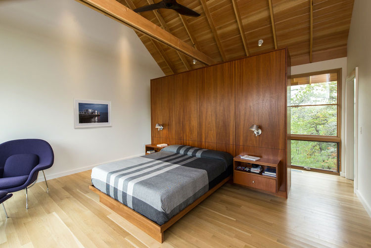 Modern bedroom in Cape Cod with a Womb chair