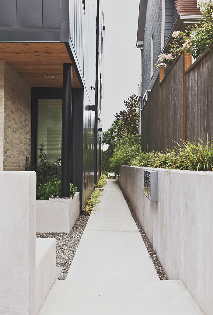 Modern multifamily home in Seattle with concrete pavers and wooly thyme