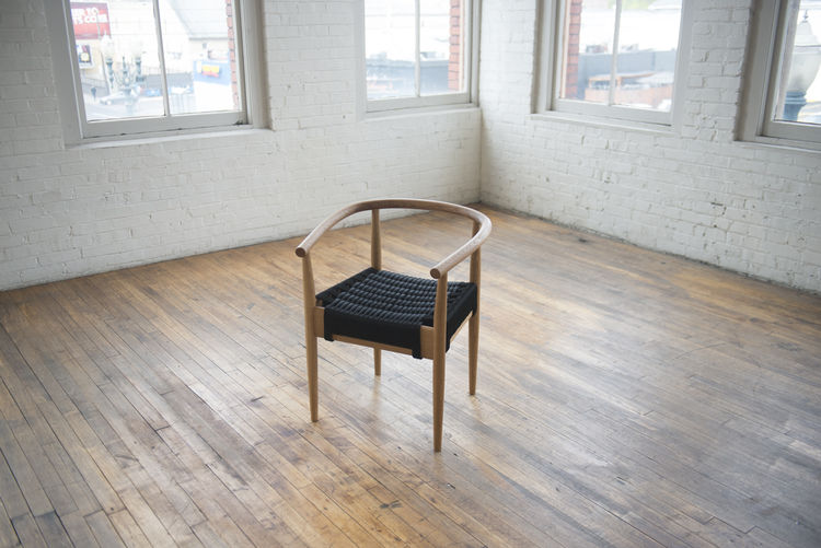 Captains Chair with a woven seat by Phloem Studio