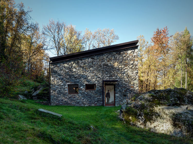 Entrance of stone-clad Alpine home.