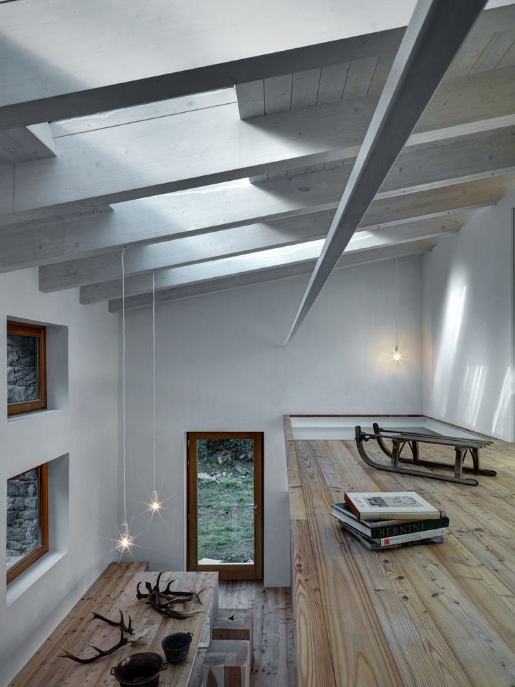 Bright and airy second floor study of Italian Alpine home.