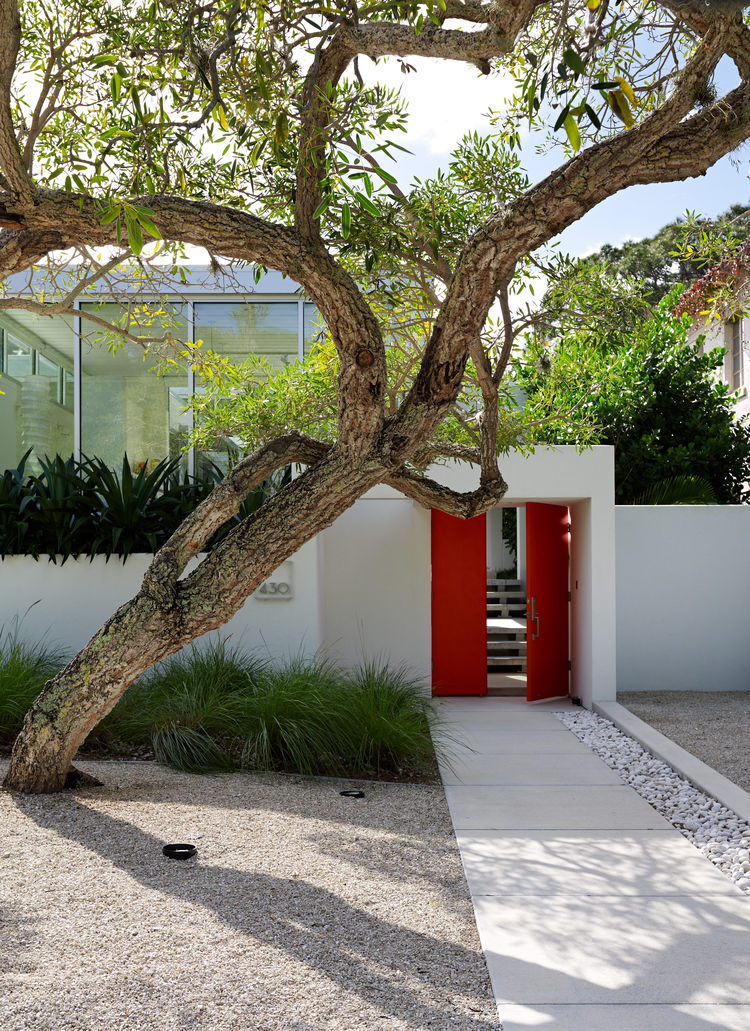 Modern Florida seaside home with benjamin moore tomato red door
