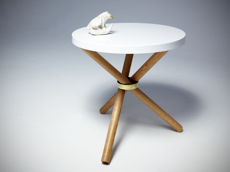 Powder-coated steel tabletop on oak legs with brass ring