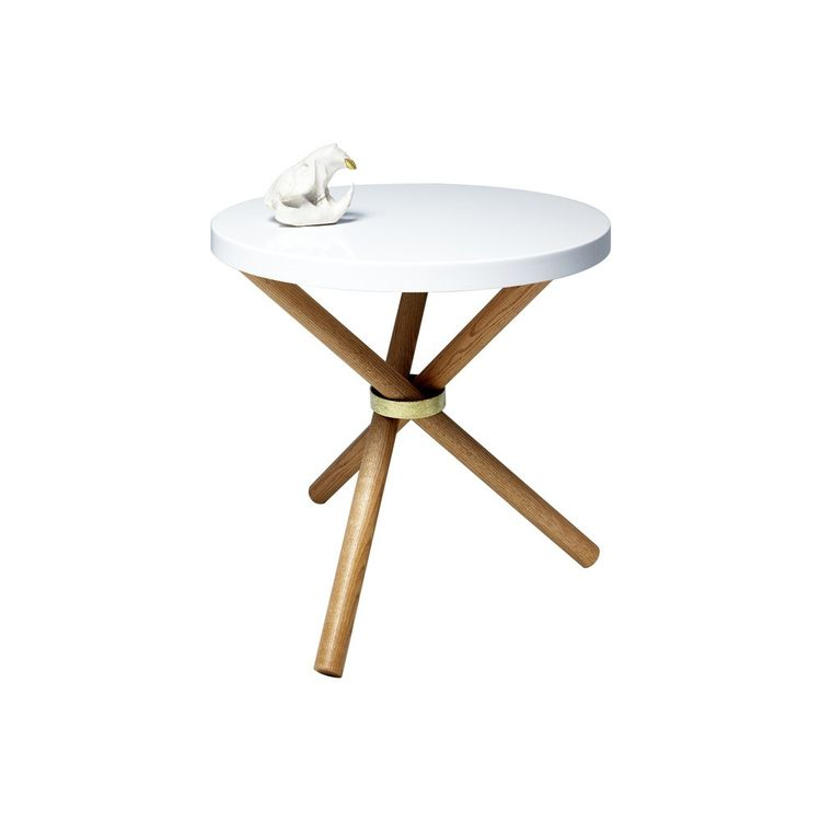 Modern table with sculptural tripod base