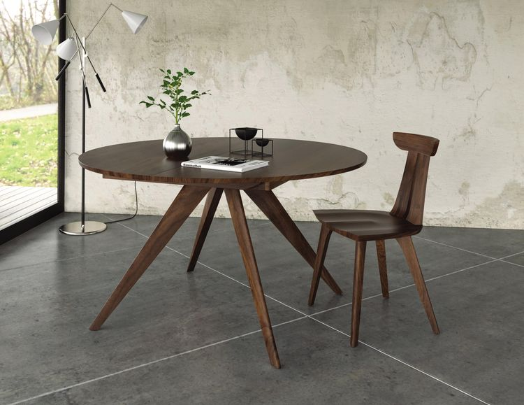 Round expanding walnut dining table