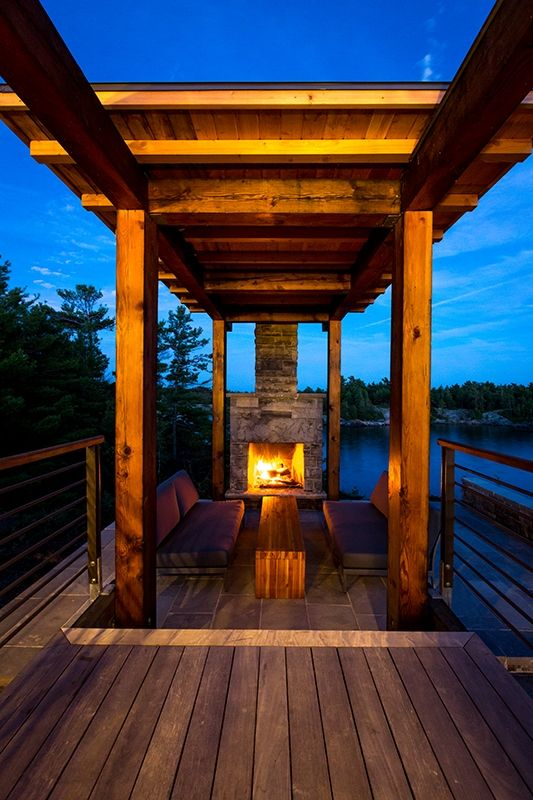Charles Gane cottage outdoor fireplace ipe deck.