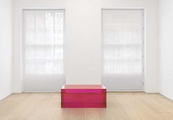 Donald Judd reddish pink Plexiglass box.