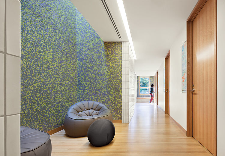 Dorm at Haverford with patterned wall coverings and Ligne Roset furnishings
