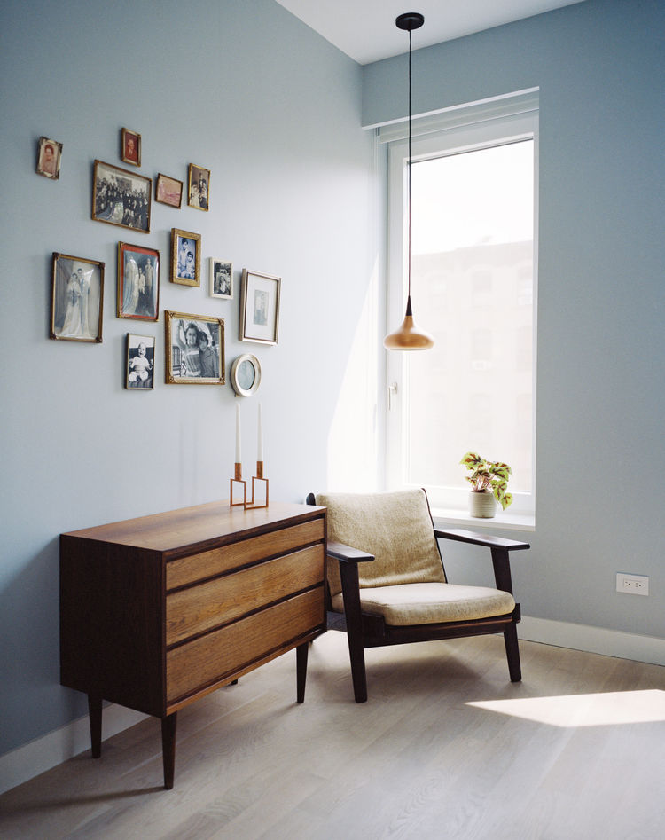 The home office is furnished with a vintage Hans Wegner armchair and a pendant by Jo Hammerborg.