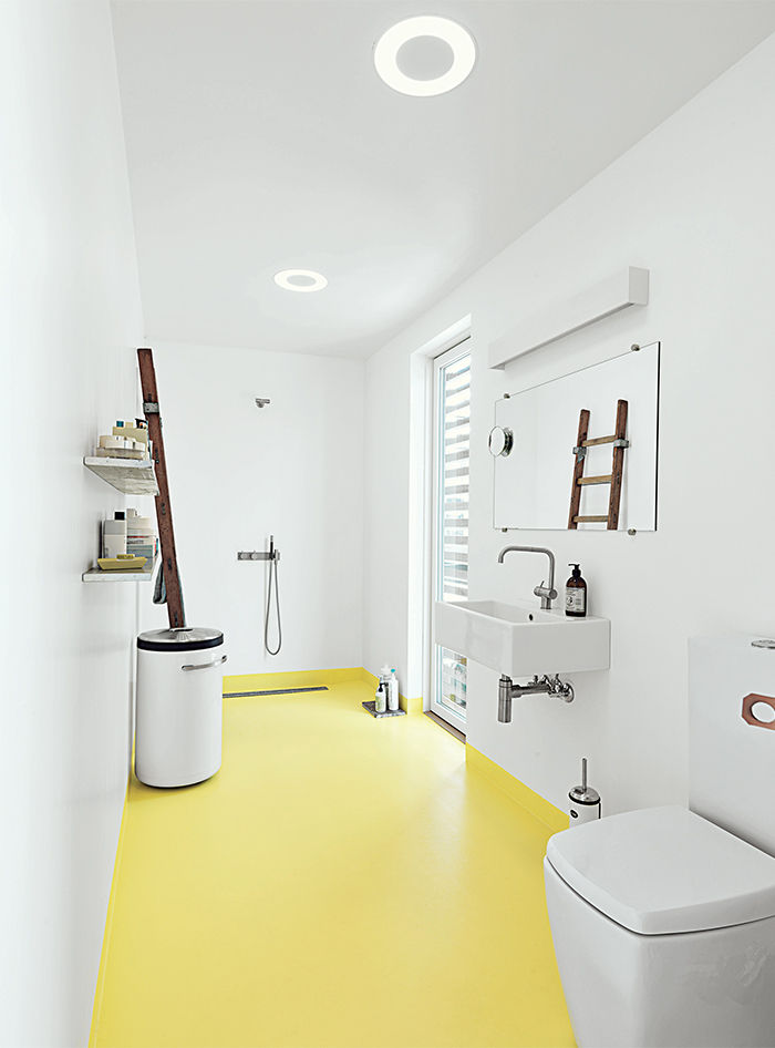 Modern bathroom with yellow floors