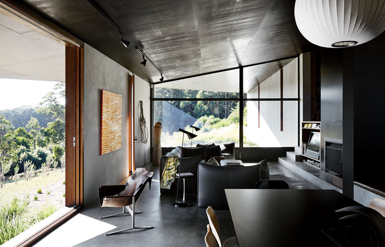 Living room with Arne Jacobsen AJ floor lamp, Le Bambole sofa in home designed by Kirsten Thompson Architects.