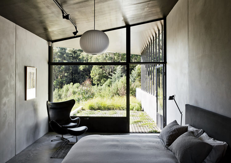 Master bedroom with Paolo Piva bed in house designed by Kirsten Thompson Architects.