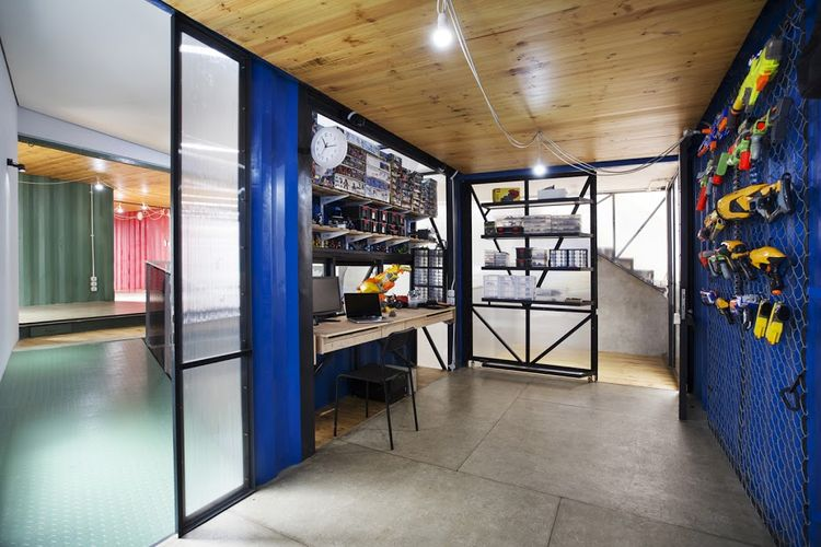A hobby room in a shipping container house.