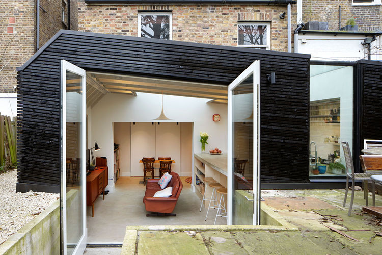 Kitchen extension in London with a recycled timber frame