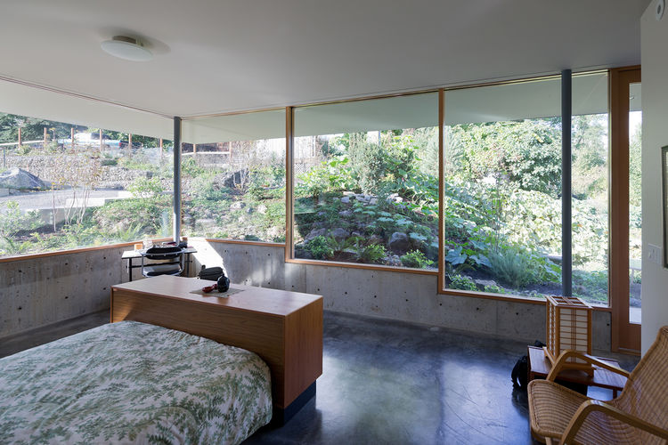 modern master bedroom fir mullions concrete walls floors