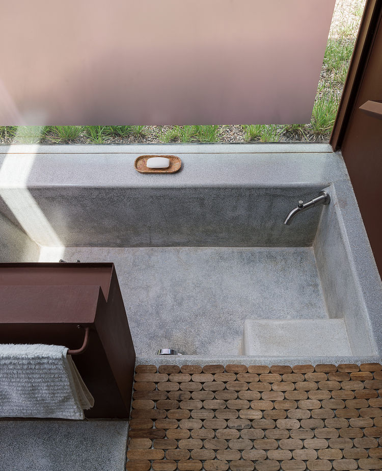 Terrazzo and granite floors blend seamlessly in this bathroom