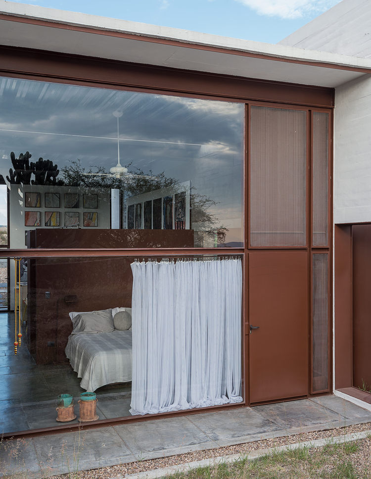 Welded-sheet steel partitions a home in Mexico
