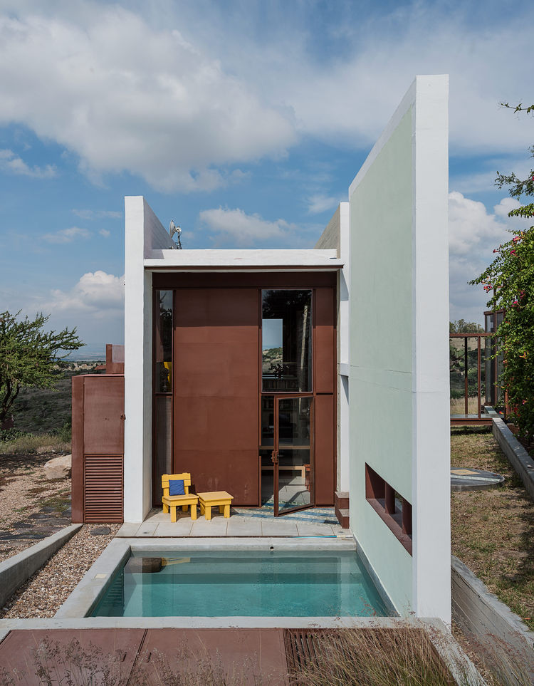 A small soaking pool sits outside a studio in Mexico