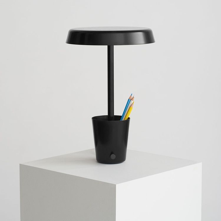 Table lamp with convenient storage cup