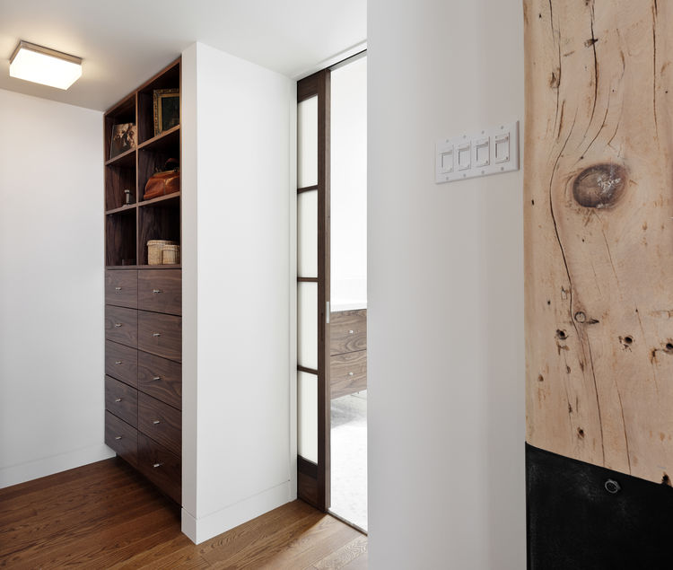 Custom walnut organizer in 850 square-foot Montreal apartment renovation by Gepetto.