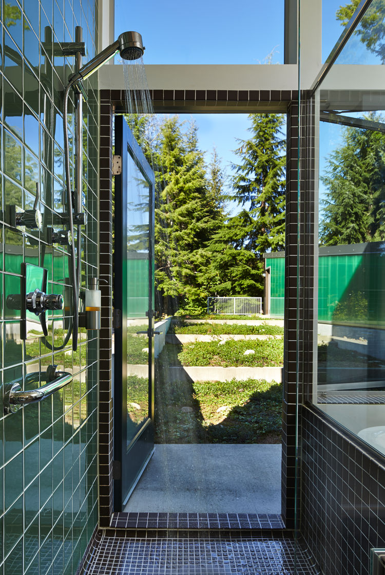 Shower with American Olean porcelain tile in modern Seattle cabin by David Coleman.