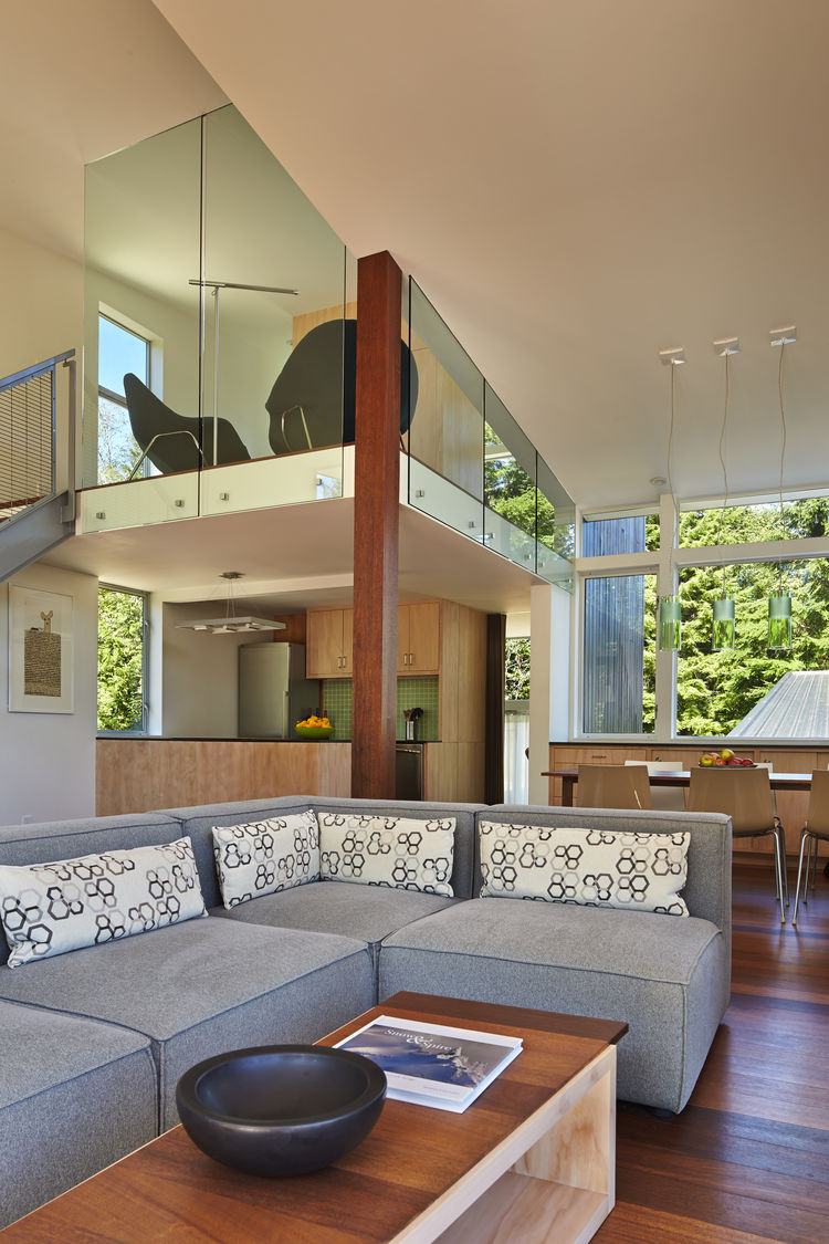 Focus One couch by Kasala and pendant light from Kartell in living room of modern Seattle cabin by David Coleman.