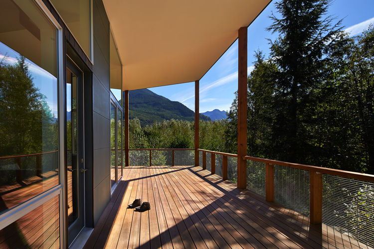 Patio with Red Balau hardwood and Messmer oil finish in modern Seattle cabin by David Coleman.