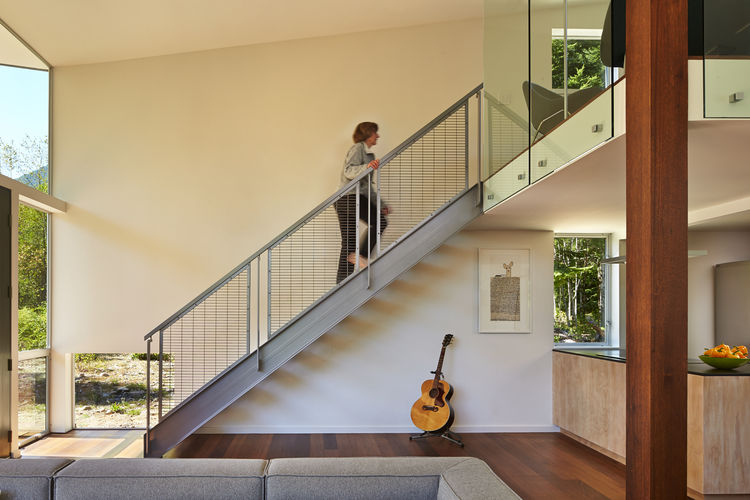 Custom steel stairs in modern Seattle cabin by David Coleman.